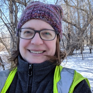 Selfie with a winter hat and a green safety vest.